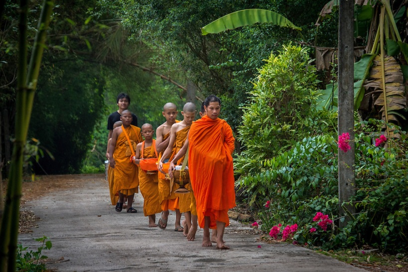 Young Novice Monks First Walk for Alms in  Rural Nakhon Nayok, Thailand. © Lee Craker